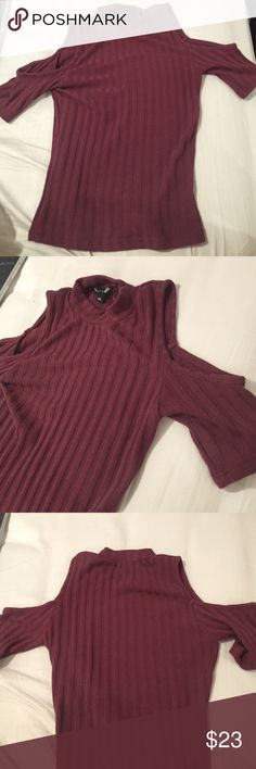 Kendall and Kylie maroon turtleneck shirt The shoulders are open and the neck line goes up past the collarbones. Is tight and can be cropped. Very cute! Kendall & Kylie Tops Crop Tops