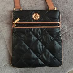 Tory Burch Crossbody beautiful Tory Burch nylon and leather Crossbody. Worn only a handful of times and in perfect condition except the water marks shown on the strap on that one place. Looking to downsize my collection so make an offer! Tory Burch Bags Crossbody Bags