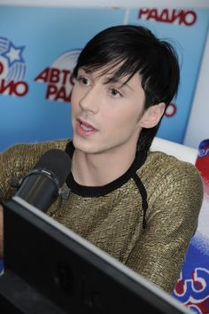Johnny doing a radio show after the Olys. He looks like an elfling...2010.