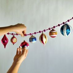 Christmas garland. take the tops of your ornaments, hook over the beads, and back into the ornament!