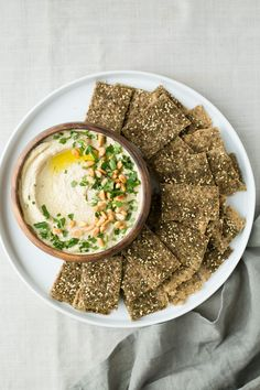 Roasted sunchokes make a wonderful base to this delicious and creamy hummus. A perfect snack served with crispy and flaky gluten-free za'atar crackers.
