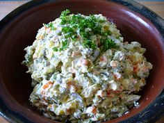 """Behold the power and the glory of the Russian cold appetizer spread (commonly served to open a festive holiday meal, alongside an array of other delicacies): the """"Olivier"""" salad! So called after a ..."""