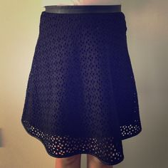 Ann Taylor black skirt Black Skirt hole punch design, worn few times, no tear, no fading! Ann Taylor Skirts