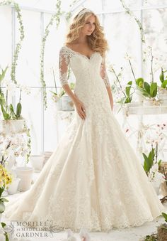 """Wedding Dresses and Wedding Gowns by Morilee featuring Alencon Lace Appliques on Net Frosted with Delicate Beading and Scalloped Hemline Available in Three Lengths: 55"""", 58"""", 61"""". Colors Available: White, Ivory, Ivory/Light Gold."""