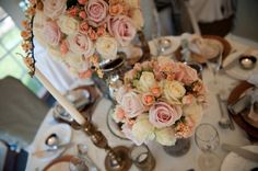 Beautiful vintage wedding flowers with peach and pink tones. Creating a rustic, romantic table!