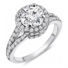 Diamond Engagement Ring. You can customize the center stone between 0.50-1.00ct round brilliant cut diamond. Surrounded by 0.40ct round cut diamonds in a halo setting with diamonds half way down the ring. Handcrafted in 14k Gold, 18k Gold, or Platinum 950 setting.