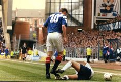 John McStay is grounded after being the victim of a headbutt by Rangers Duncan Ferguson. Picture: Neil Hanna