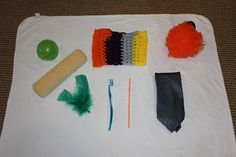 Awesome ideas for infant sensory play! Sensory ball, paint roller, little blanket, feathers, toothbrush, straw (to blow air), silk tie, bath scrubber. start from the feet first and work your way up.  This way something is not just thrown into her face.By providing your infant with the opportunity to use their sense of touch you are:  boosting  tactile development   improving sociability   stimulating cognitive development   encouraging language development   building motor skills and…