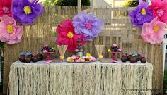 Check out these awesome Hawaiian luau party decorations... LOVE the tissue paper flowers!