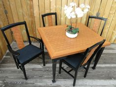 This dining set was handmade in Germany. Made up of hundreds of individual diamond shaped pieces assembled in Q*bert fashion. I painted as little as possible black to update it and showcase the quarter sawn oak which was stained in a wonderfully contrasting Prairie Wheat. Modern Vintage