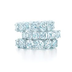 Tiffany diamond wedding bands. From top: Oval, emerald cut and round brilliant, all in shared settings. #TiffanyPinterest