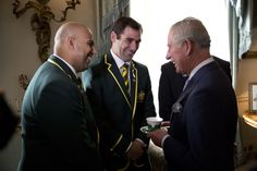 Prince Charles, Prince of Wales (R) talks with Australia national rugby league team manager Gareth Holmes (L) and team captain Cameron Smith (C) during a reception for the Rugby League World Cup at Clarence House on October 29, 2013 in London, England.