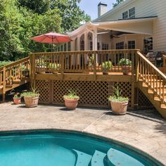 Traditional pressure treated deck with steps down to pool provides space for dining, too. A covered, open porch adds to the outdoor living space — and opportunities to relax or entertain. Decking Fence, Patio Stairs, Fencing Companies, Decking Material, Outdoor Living, Outdoor Decor, Deck Design, Pool Ideas, Outdoor Areas