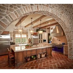 Pretty kitchen with stone walls and terracotta herringbone flooring brings us travelling to the past. #rumahkukitchen