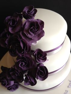 Wedding cake with dark purple sugar roses