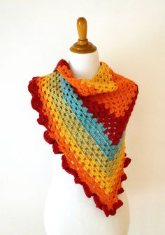 The Happy Go Lucky Shawlette is fun, colorful, and super easy to stitch up. A simple granny triangle shows off the self striping y...