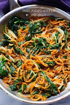 Sweet Potato Noodles with Spinach - Delicious, adaptable, vegetarian recipe with garlicky sweet potato noodles, spinach, onions, and a sprinkle of cheese.