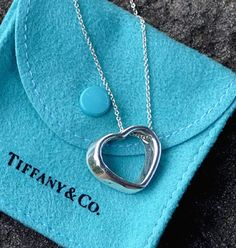 7fb22f858d SOLD - Tiffany and Co. Silver Open Heart Pendant on 16