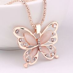 Material: Alloy Crystal Colour: Rose Gold plated Design: Tassel sweater long necklace Suitable for women jewellery Butterfly Jewelry, Butterfly Pendant, Butterfly Necklace, Big Butterfly, Butterfly Design, Rose Gold Jewelry, Long Chain Necklace, Long Pendant Necklace, Opal Necklace