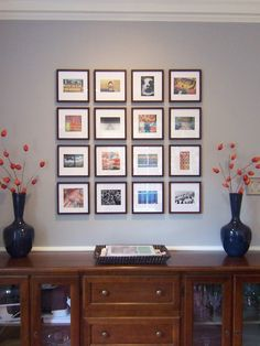 Postcards mounted in matching frames with mounts unifies and displays an eclectic mix of pictures. The square still work against the rectangular frames