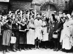 Mahatma Gandi is greeted by a crowd of female textile workers during a vist to Darwen, Lancashire, UK in 1931.