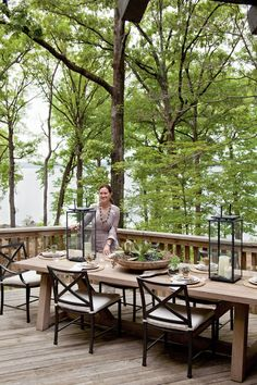Pair a wood table with iron chairs for rustic lakeside dining. Fill hurricanes with river rocks and pillar candles of varying height for a touch of elegance.