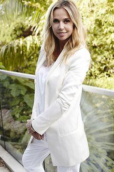 Liz glows in white at her Bondi pad