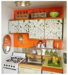 What a great use of color to pop a tiny kitchen.  I believe the cabinets are covered with a removable paper...perfect for renters.
