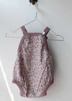 beautiful little floral sunsuit. the plum edging is the icing on the fashion cake. pigve #estella #baby #fashion