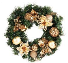 Decora tu puerta de entrada con la belleza de los tonos dorados #Navidad #Decoración #Home