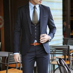 This!!! But dark grey instead of navy, keep the shirt colour, and change the ugly tie for a slim one that matches the suit.