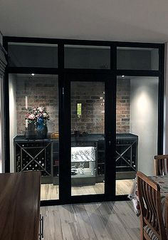 Glassflex® framed system for a wine room and walk-in fridge. It insulates enough to keep the cold inside the room.