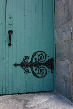 turquoise door love the wrought iron detailing