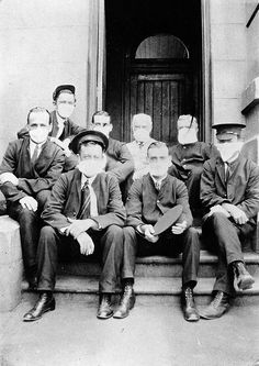 Australians during the Spanish flu epidemic. The flu reached Australia in 1919 and killed 12,000 people.