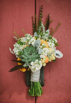 bouquet with succulents + feathers // photo by Jason + Anna Photography, flowers by Steven Bruce Design // http://ruffledblog.com/woodsy-catskills-wedding