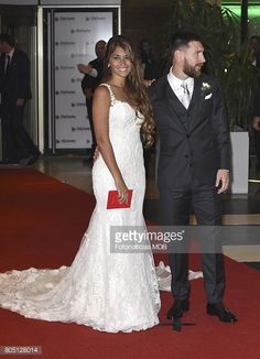 Lionel Messi and Antonela Roccuzzo greet the press after their civil wedding ceremony at the City Center Rosario Hotel & Casino on June 30, 2017 in Rosario, Argentina.