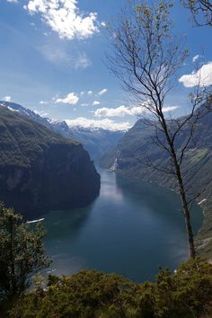 "This is the view to the west from a viewpoint a few hundred meters from ""Ørnesvingen"" (eaglesturn) above the Geiranger fjord. The fjord is about 100-200 meters below just a few meters forward. (And no, there are no security rails here)"