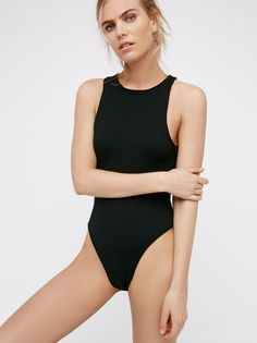 She's A Babe Bodysuit | Simple bodysuit featuring a soft and stretchy fabrication for effortless layering. Snap button closures at the gusset.