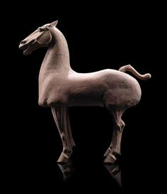 A RED POTTERY FIGURE OF A HORSE, China, Han Dynasty.