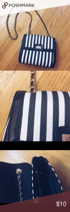 PREPPY sailor navy striped bag Cute and holds water bottle and phone! Structured and cute. Small makeup stain shown and price reflects Bags Crossbody Bags