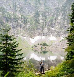 couple lake hiking engagement photos