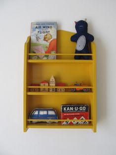 painted spice rack as kid storage (do my kids have toys that are that cute? hm)