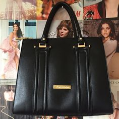 """Catharine Malandrino tote Gorgeous and roomy without looking like """"luggage""""! This black tote can easily handle your daily carries like a water bottle, wallet, makeup kit or your lunch. There are two zippered pockets on either side of and the same height as the main pocket. It has hooks for a shoulder strap but didn't come with one. BNWOT. Catherine Malandrino Bags Totes"""