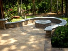 Patio fire pit. Going to do something like this, but integrate the pit into the wall; half moon or something.