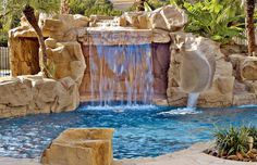 Swimming pool with rock waterfall grotto and rock water slide by Blue Haven Pools Backyard Pool Landscaping, Backyard Pool Designs, Swimming Pool Designs, Pool Spa, Swimming Pool Waterfall, Rock Waterfall, Blue Haven Pools, Swimming Pool Pictures, Gardens