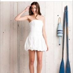 NWT white Lilly Pulitzer Strapless Eyelet dress Adorable Lilly strapless dress with drop waist and flirty bubble skirt.  Has absolutely no stretch.  The perfect little summer dress. Lilly Pulitzer Dresses