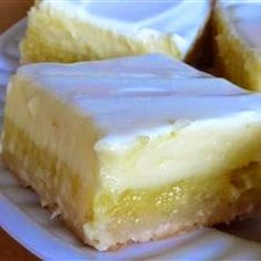 """Cheesecake Lemon Bars ~ A light lemony cheesecake dessert that makes two layers, one lemony layer, and another cheesecake layer. You'll be coming back for more!"""""""