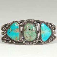 "#adobegallery - Three-stone Turquoise and Sterling Silver Bracelet. Category: Bracelets Origin: Diné - Navajo Nation Medium: Sterling silver, turquoise Size: 5-3/4"" inside end-to-end; 1-3/8"" opening; 1-3/16"" width Item # C3789B"