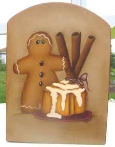This is a paper towel holder that my husband cut for me. I painted a gingerbread man with a sticky cinnamon bun and cinnamon sticks. The edge is Gingerbread Crafts, Christmas Gingerbread Men, Gingerbread Decorations, Christmas Art, Christmas Decorations, Wooden Crafts, Diy Crafts, Fawn Colour, Pintura Country