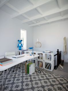 GET THE LOOK @ IKEA // The desk:VIKA RUNTORP leg with caster, VIKA AMON table top in white,SNILLE swivel chair in white The storage: EXPEDIT bookcases in white (2x2 or 2x4) The floor (I looked for rugs with either a similar color scheme or repeating geometric motif): ALVINE RANG rug, DAGNY rug     [ viaThe 'Grand Dame' of ASKarchitects in Piraeus, Greece]